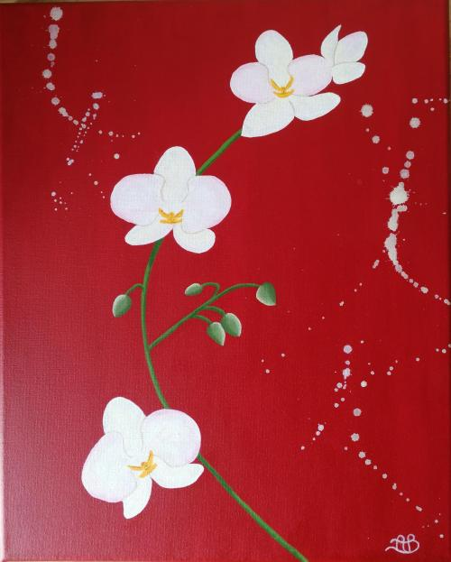 Orchidée sur fond rouge